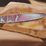Knife on toast, with reflection of Marmite jar