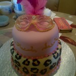 Mask and leopard print cake